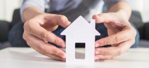 businessmen hold house model in hand 1 e1611158991583